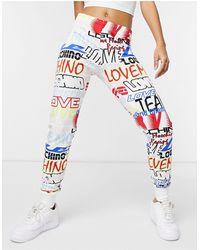 Love Moschino Leggings con logo stampato - Bianco