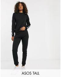 ASOS ASOS DESIGN Tall – Trainingsanzug aus Sweatshirt und Jogginghose mit Taillenschnürung und kontrastierender Paspelierung - Schwarz