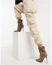 SIMMI Shoes Simmi London - Olivia - Stivaletti con dettagli extra larghi e tacco beige - Neutro