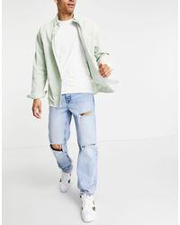ASOS Jeans dritti con strappi profondi lavaggio blu medio vintage