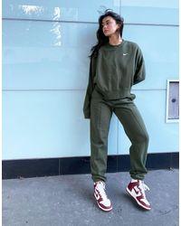 Nike – Kastenförmiges Oversize-Sweatshirt mit kleinem Swoosh-Logo - Grün