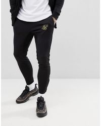 SIKSILK - Skinny Joggers In Black With Gold Logo - Lyst