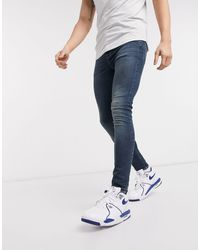 ASOS Spray On Jeans Van Powerstretch-denim - Blauw