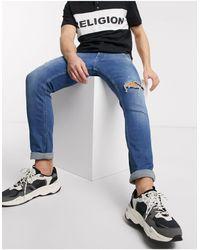 Religion – Vicious – Enge, halbverwaschene Jeans im Used-Look - Blau