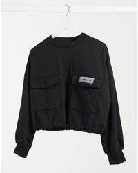 Sixth June Sudadera cargo corta en color negro con cintura tipo trenca