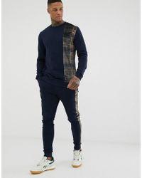 ASOS - Survtement avec sweat-shirt et pantalon de jogging skinny empicement carreaux et bandes sur les cts - Lyst