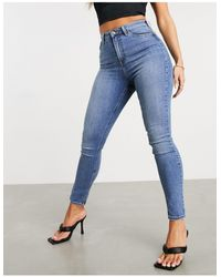 ASOS Hourglass - Jeans skinny a vita alta modellanti e push-up lavaggio medio - Blu