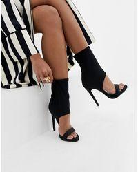 SIMMI Shoes Simmi London - Stivaletti neri con tacco e cut-out - Nero