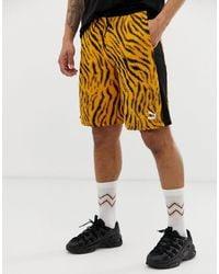 PUMA Wild Pack - Short à imprimé tigre - Orange