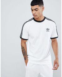 adidas Originals Camiseta blanca con tres rayas adicolor - Blanco