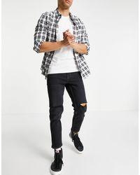 New Look Jeans slim corti con strappi sulle ginocchia colore nero