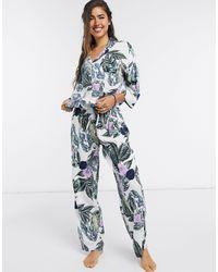 ASOS Pigiama pantaloni e camicia a maniche lunghe con stampa tropicale verde e viola - Blu