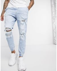Bershka Joggers en jean avec déchirures - Bleu