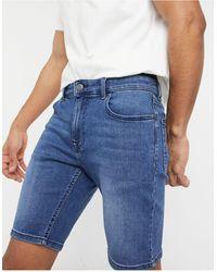 ASOS - Shorts vaqueros elásticos con lavado azul oscuro y diseño - Lyst