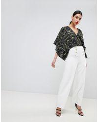 Flounce London Pantaloni sartoriali con fondo ampio e bottoni oro - Bianco