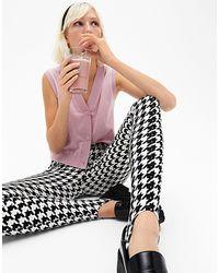 Monki Sarah - legging d'ensemble motif pied-de-poule avec sous-pieds - Noir