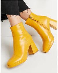 ASOS – Rhona – Stiefel mit Plateausohle - Gelb