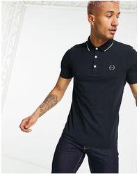 Armani Exchange – es Polohemd mit Zierstreifen und Logo - Blau