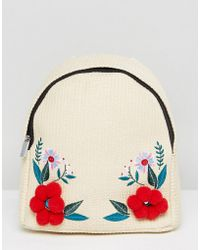 Skinnydip London - Straw Backpack With Floral Pom Pom Detail - Lyst