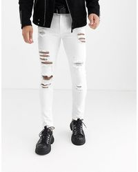 ASOS Super Skinny Jeans With Heavy Rips - White