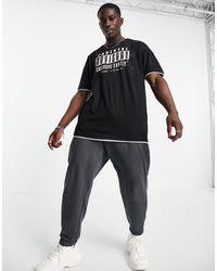 Liquor N Poker T-shirt oversize avec logo Parental Advisory - Noir