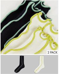 Weekday Calcetines es con costura expuesta - Amarillo