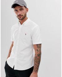 29e5a3a7f5 Camicia Oxford slim bianca a maniche corte con bottoni e logo - Bianco
