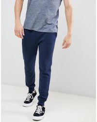 Hollister Core Icon Logo Cuffed jogger In Navy - Blue