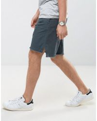 ASOS - Oversized Shorts With Rip And Repair Details And Raw Edge - Lyst