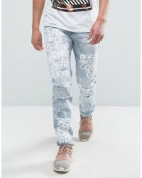 Reason - Jeans In Light Wash With Distressing And Scribble Print - Lyst