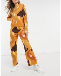 Never Fully Dressed Pantalon évasé d'ensemble en maille à imprimé abstrait varié - Orange