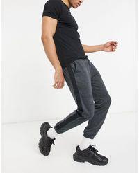 SIKSILK Joggers grigi a quadri tono su tono con pannello laterale e fondo gamba elasticizzato - Grigio