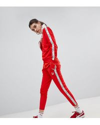 PUMA - Exclusive To Asos Taped Side Stripe Track Trousers In Red - Lyst