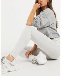 The Couture Club Legging taille haute avec imprimé contour du logo - Gris