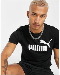 PUMA Essentials - T-shirt nera con logo grande - Nero