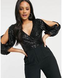 Forever New Tuta jumpsuit decorata con scollo profondo e maniche aperte nera - Nero