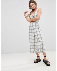 2f5fa524b34 ASOS - Asos Jumpsuit In Textured Check With Wrap Front And Buttons - Lyst