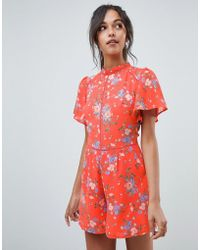 Oasis - Playsuit With Ruffle Sleeves In Orange Floral Print - Lyst