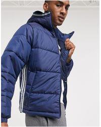 adidas Originals Cappotto imbottito con 3 strisce blu navy
