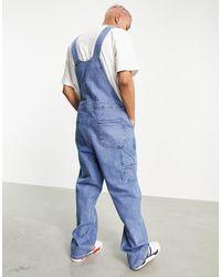 ASOS ASOS Actual - Salopette di jeans extra larga lavaggio blu medio