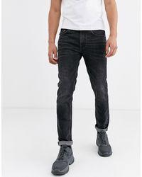 Love Moschino Jean slim avec poche arrière à logo - Bleu