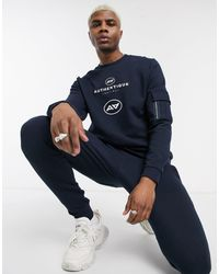 ASOS Tracksuit With Skinny jogger And Authentique Print - Blue