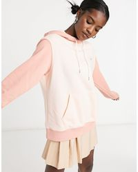 Nike Hoodie color block oversize avec petit logo métallisé - Corail ton sur ton - Rose