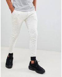 ASOS - Joggers muy ajustados de pelillo blanco con puos y cinturilla en contraste de - Lyst