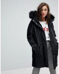 River Island - Faux Fur Hood Oversized Padded Coat - Lyst