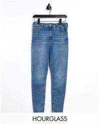 ASOS Hourglass - Jean skinny taille haute effet sculptant et rehaussant - Délavage moyen foncé - Bleu