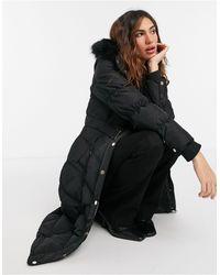River Island Abrigo largo negro acolchado con capucha
