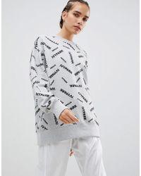 Ivy Park Graues Sweatshirt mit gestreutem Logo