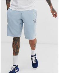 True Religion – Kurze Jogginghose mit Hufeisen-Logo - Blau