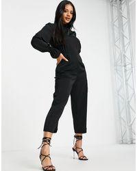 AX Paris Tuta jumpsuit accollata nera - Nero